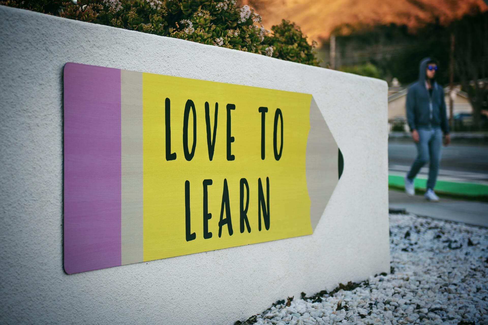 Trainings für Teams - Love to learn Zeichen